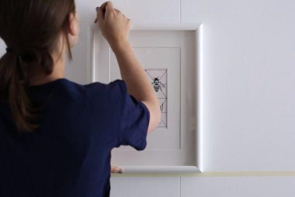 Como pendurar um quadro